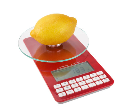 Measurement and weight calorie fruit lemon. On special scales. photo