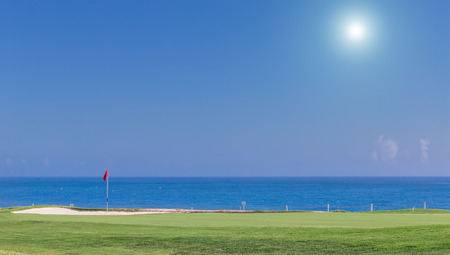 course: Beautiful summer view of a golf course. With a background of the sea. Stock Photo