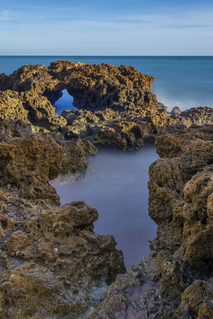 inflow: Little Inflow of water in the sea cliffs. Seascape.