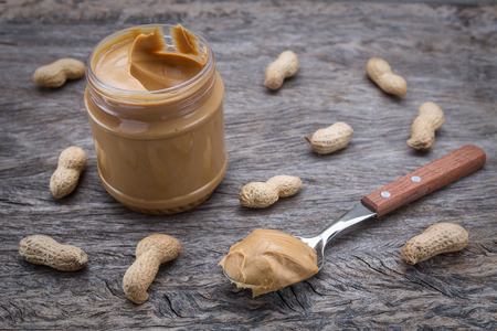 Peanut cream in a jar. Dietary foods for the heart. photo