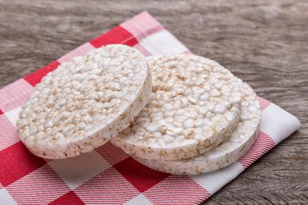 galettes: Rice galettes on a kitchen napkin. On wooden texture.