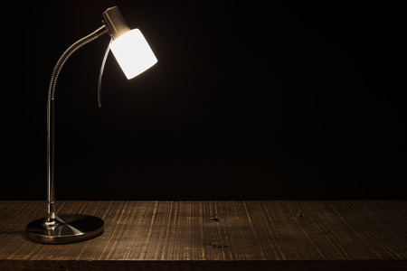 dark interior: Lamp Shade on the table. In a dark background. Stock Photo