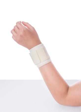 imposed: Damaged wrist. Orthopedic bandage is imposed. Stock Photo