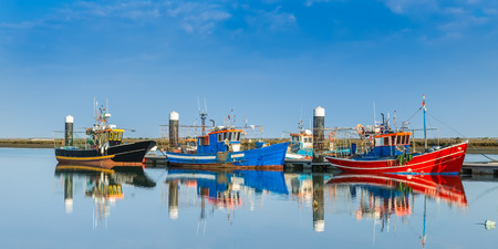 Fishing boats moored at the dock. Industrial ships. photo
