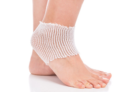sprained joint: Elastic bandage on the ankle. Sprain.