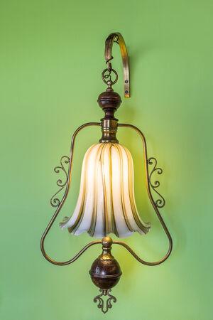 luminaire: Ancient vintage luminaire. On the green wall.