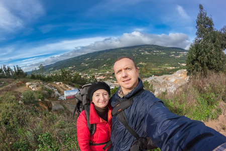 monchique: Young family hiking in the mountains. With a backpack in Portugal Monchique. Stock Photo