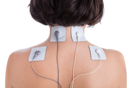 Orthopaedic treatment electrostimulator Electrodes of the girl in neck. Standard-Bild