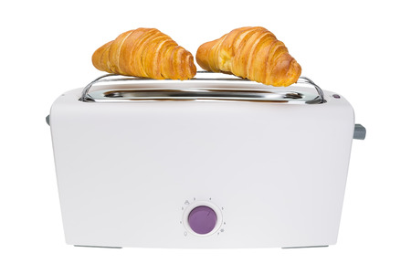 Croissants are baked in a toaster. For breakfast. photo