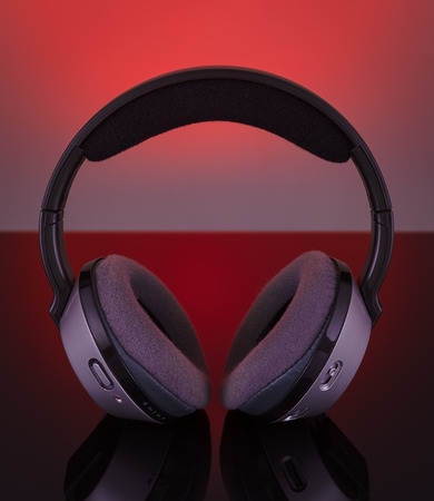 Professional wireless audio headphones. On a red background. photo