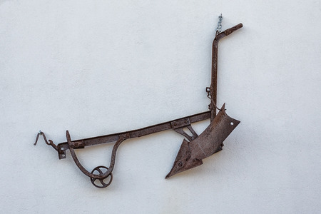 plough land:  exhibit classic plow. For plowing the land.