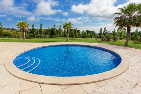 Modern round pool. In the tropics, near the hotel in the summer.