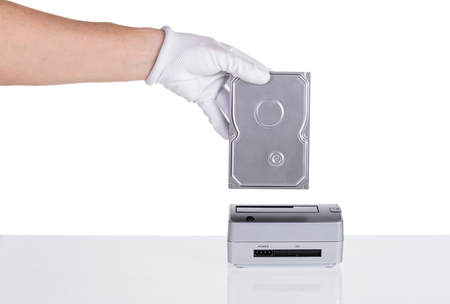 megabyte: Hard drive in his hand is connected to the docking station. For saving data.