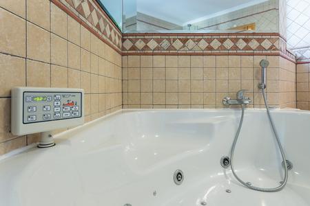 jacuzzi: Luxury Jacuzzi bath. With the control panel.