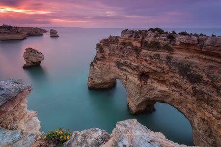 pink sunset: Sea pink sunset on the beach Marinha. Portugal Algarve.