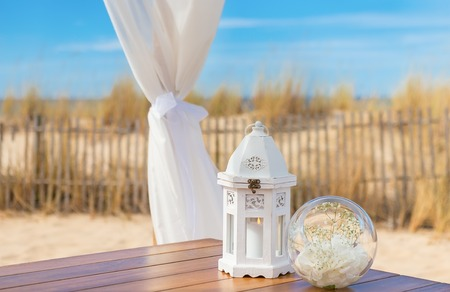 luminaire: Wedding romantic decoration. Candle in a luminaire.