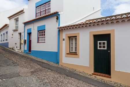 Traditional Portuguese street. With the paving stones in the street.