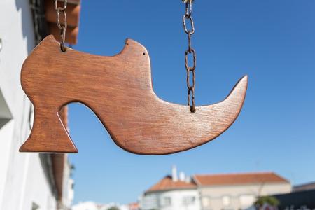 Symbol craft shoemakers. Wooden shoe cobbler.