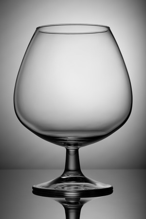 alcoholic beverages: Empty glass snifter on the leg. For alcoholic beverages.