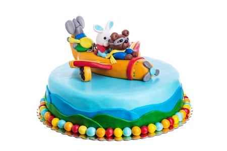 Creative cake animals, birthday of children. On a white background. Standard-Bild