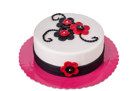 pastes: Birthday cake from sugar pastes red flowers. On birthday. Stock Photo
