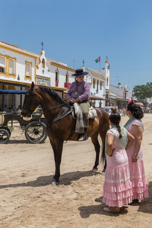 atheist: El ROCIO, ANDALUCIA, SPAIN - MAY 22: Romeria after visiting the Sanctuary goes to village.  2015  It is one of the most famous pilgrimage of Spain. This pilgrimage passes from the 15th century.