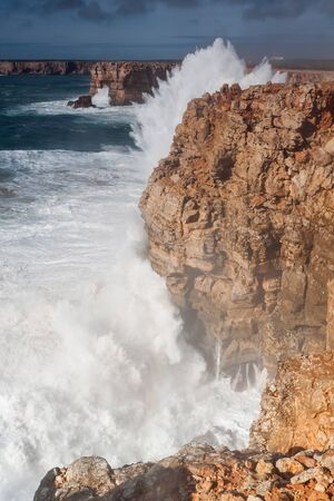 power giant: Splashes waves beat against the rocks. Sagres in Portugal.