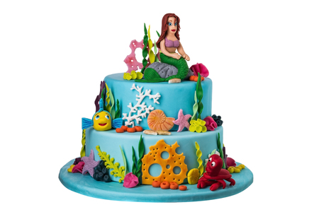 Themed cake on the sea of sugar paste, the mermaid. On a white background. Stock Photo