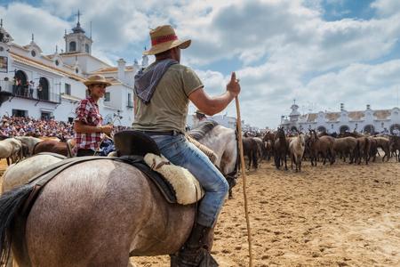 El ROCIO, ANDALUCIA, SPAIN - 26 JUNE 2016 Family of Spanish equestrians, horses, guides for baptism. Editorial