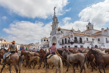 El ROCIO, ANDALUCIA, SPAIN - 26 JUNE 2016 :Religious celebration, the baptism of wild horses in front of the church. Editorial