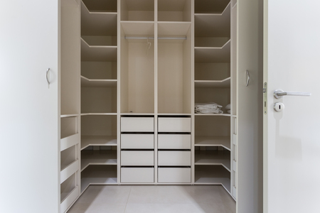 Modern apartment interior with huge wardrobe. White. Standard-Bild
