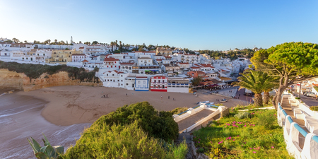 Panorama of the city with restaurants of Carvoeiro. with tourists. Stok Fotoğraf - 76387403