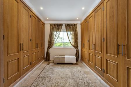 checkroom: Empty room wardrobe for clothes,