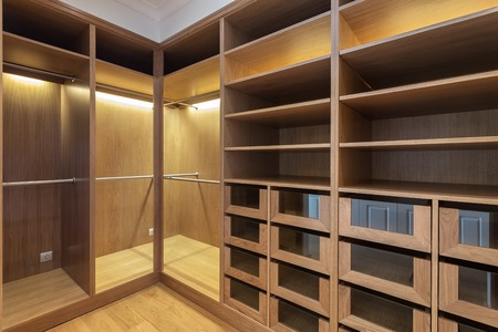 An empty wardrobe made of wood, for family.
