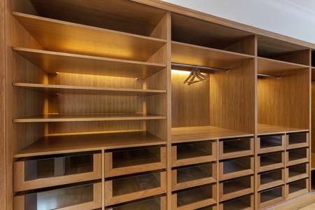 Large wardrobe closet, with empty shelves.