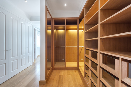 checkroom: Cabinets and an empty dressing room made of wood, for family.
