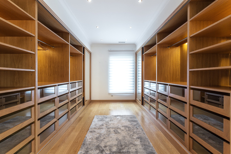 Large wardrobe room, with empty shelves.