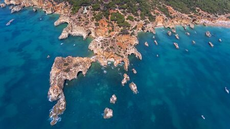 Aerial. View from the sky of coast of Portimao. Beaches Submarino, and praia Joao de Arens.