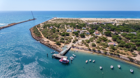 Breakwater channel in Quatro aguas, Tavira Island. View from sky