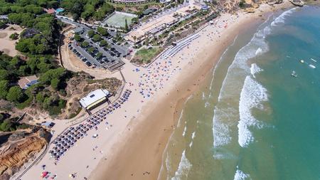 Aerial. Beach strip at Olhos de Agua, Albufeira.