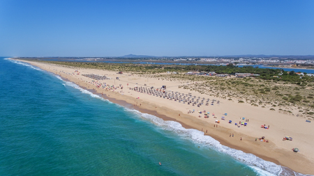 Aerial. Beach and tourists on the island Tavira. Algarve