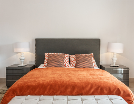 bedroom design: Modern bedroom has a bedroom with a bed and decorative pillows. Stock Photo