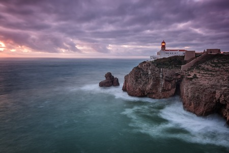 Lighthouse Cabo Sao Vicente before the storm and dramatic sky. Stock Photo