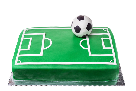 Cake for football player, soccer field and ball.