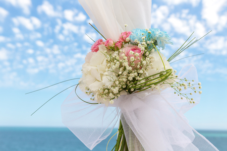 chairs: Delicious bouquet on the arch for cerimony at wedding.