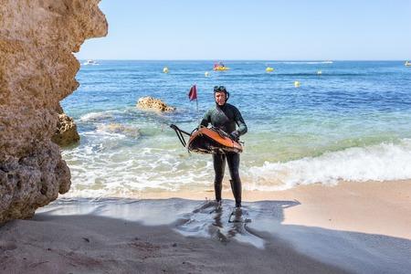 Underwater hunter preparing to dive. Underwater fishing in Atlantic Ocean.