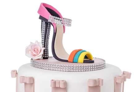 Details of wedding cake, womens shoe with a heel made of sugar paste. Stock Photo