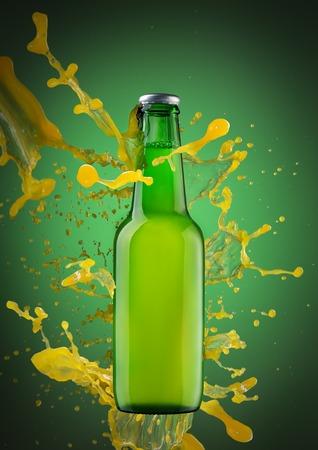 Spray a splash of juice on a bottle of drink. On green background. Stock Photo