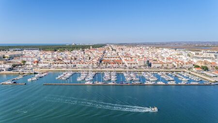 Aerial. Village VIla Real Sto Antonio on the river Guadiana, with a port for yachts and fishing boats.