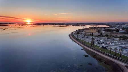 Aerial. Delightful sunrise above the old town of Faro Portugal. Stock Photo